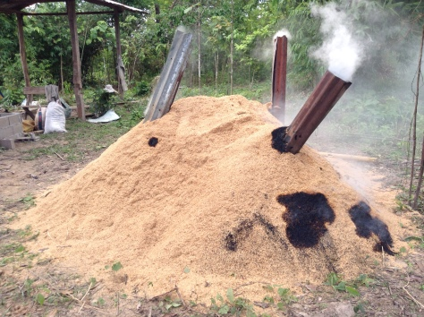 Local smallholder farmers in the Vientiane Province of Laos use this local agro-technical approach as a pyrolysis system to produce rice husk-based biochar, 2014.