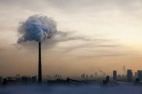 A smokestack spews soot into the smoggy skyline of the northeastern Chinese city of Changchun, in file photo. Credit/AFP